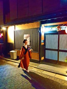 A Geisha on its way to a customer in Gion