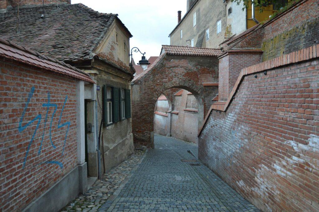 A narrow cobblestone street in Sibiu