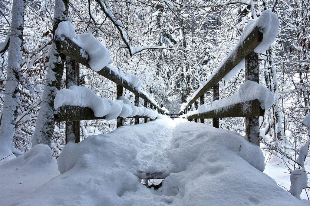 Snowy wooden bridge
