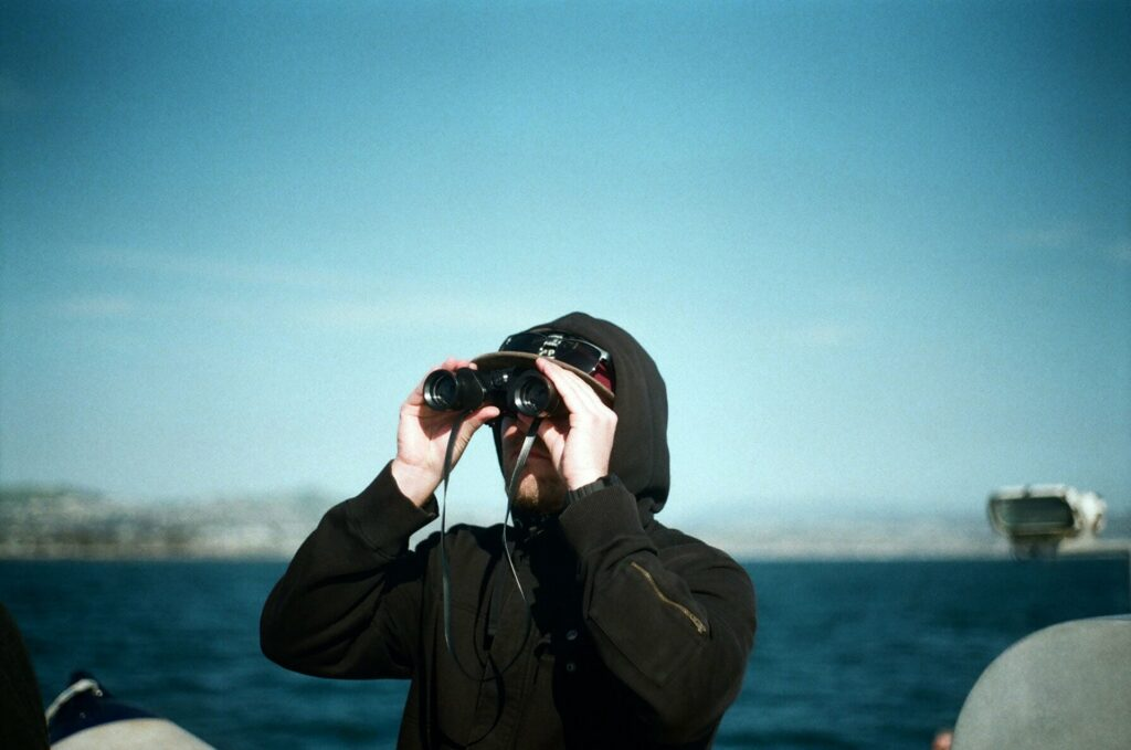 Whale watching with binoculars